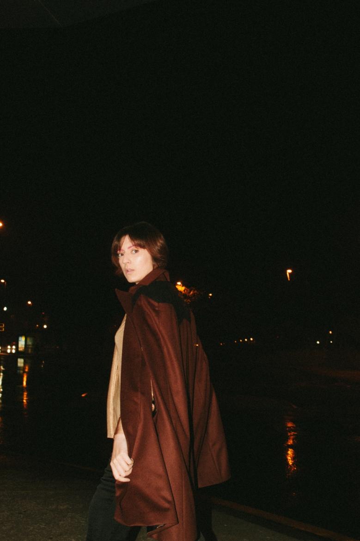 Shirt & Cloak: Cristina Piña; Pants: Zara